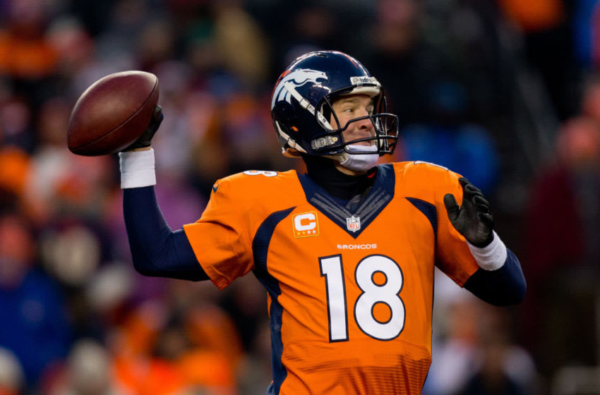 DENVER, CO - DECEMBER 8: Quarterback Peyton Manning #18 of the Denver Broncos throws a pass during the third quarter against the Tennessee Titans at Sports Authority Field Field at Mile High on December 8, 2013 in Denver, Colorado. The Broncos defeated the Titans 51-28. (Photo by Justin Edmonds/Getty Images)