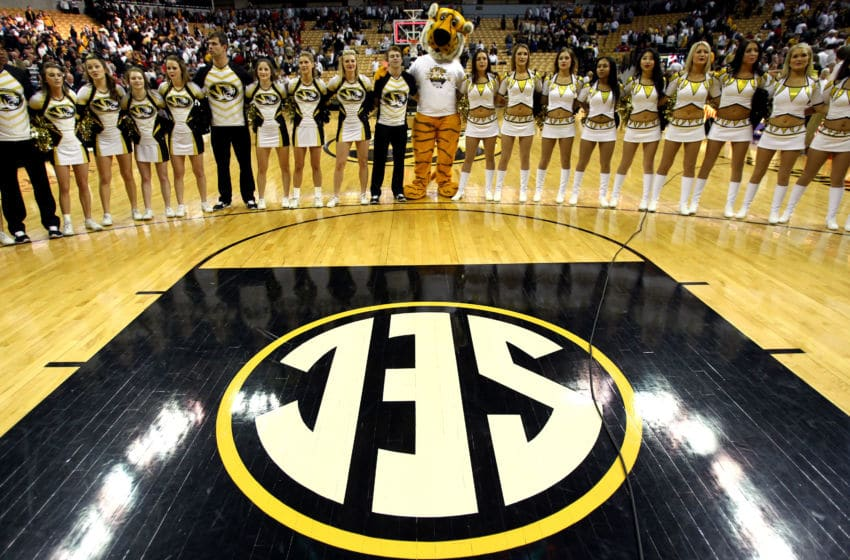 COLUMBIA, MO - JANUARY 24: The Missouri Tigers mascot, Truman, joins arms with cheerleaders to sing the school anthem after the game between the Arkansas Razorbacks and the Missouri Tigers at Mizzou Arena on January 24, 2015 in Columbia, Missouri. The Razorbacks defeated the Tigers with a final score of 61-60 to win the game.(Photo by Jamie Squire/Getty Images)