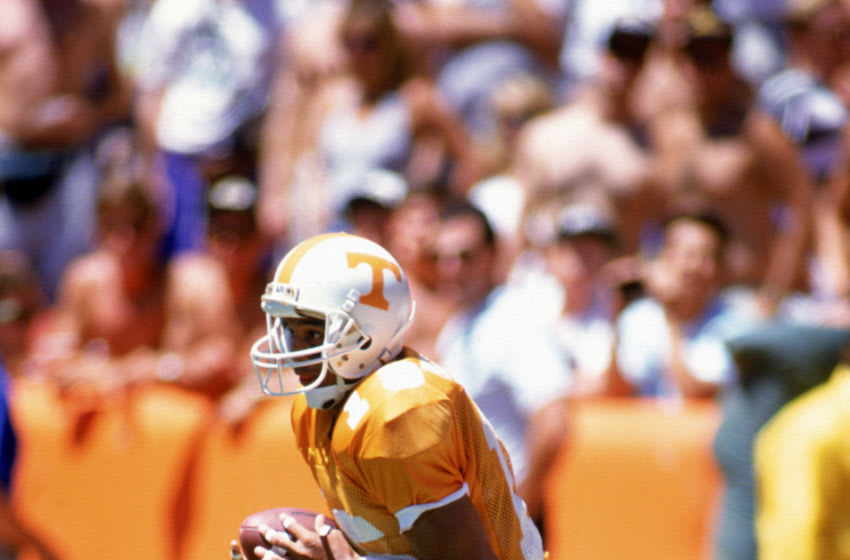ANAHEIM, CA - AUGUST 26: Wide receiver Carl Pickens #15 of the Tennessee Volunteers runs with the ball against the Colorado Buffaloes during the Pigskin Classic at Anaheim Stadium on August 26, 1990 in Anaheim, California. The Buffs and Vols tied 31-31. (Photo by Bernstein Associates/Getty Images)