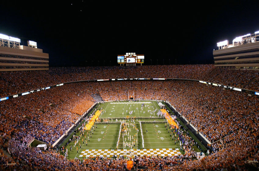 KNOXVILLE, TN - SEPTEMBER 18: A general view of the Tennessee Volunteers running onto the field during their game against the Florida Gators on September 18, 2004 at Neyland Stadium in Knoxville, Tennessee. A new attendance record was set. (Photo by Streeter Lecka/Getty Images)