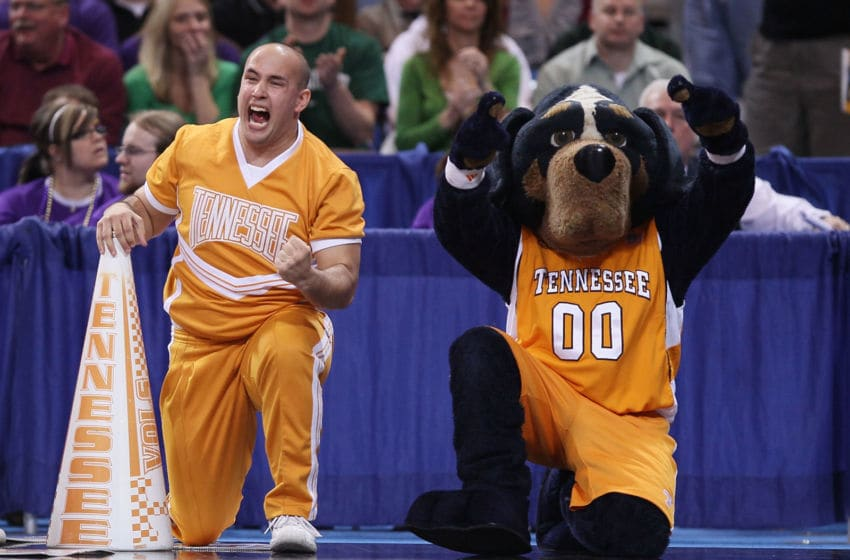 ST. LOUIS - MARCH 26: Smokey, the Tennessee Volunteers mascot, and a cheerleader celebrate the win over he Ohio State Buckeyes during the midwest regional semifinal of the 2010 NCAA men's basketball tournament at the Edward Jones Dome on March 26, 2010 in St. Louis, Missouri. Tennessee defeated Ohio State 76-73. (Photo by Elsa/Getty Images)