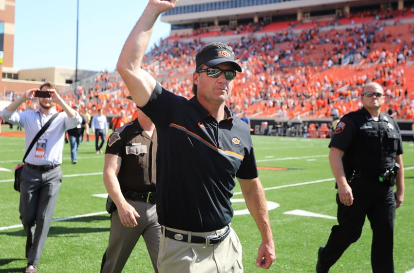STILLWATER, OK - OCTOBER 1 : Head Coach Mike Gundy of the Oklahoma State Cowboys walks off the field after the game against the Texas Longhorns October 1, 2016 at Boone Pickens Stadium in Stillwater, Oklahoma. The Cowboys defeated the Longhorns 49-31. (Photo by Brett Deering/Getty Images)