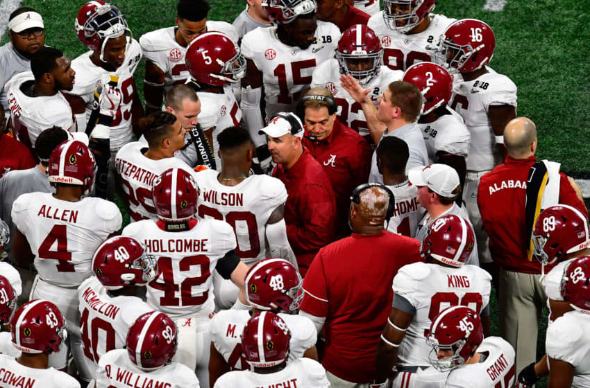 ATLANTA, GA - JANUARY 08: Head coach Nick Saban of the Alabama Crimson Tide and defensive coordinator Jeremy Pruitt talk to their team during the second quarter against the Georgia Bulldogs in the CFP National Championship presented by AT
