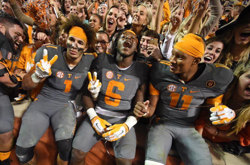 Tennessee players Jalen Hurd, left, Alvin Kamara, and Joshua Dobbs celebrate following the Vols' 38-31 win over Georgia Saturday, Oct. 10, 2015, at Neyland Stadium. Utvsugathroughtheyears28