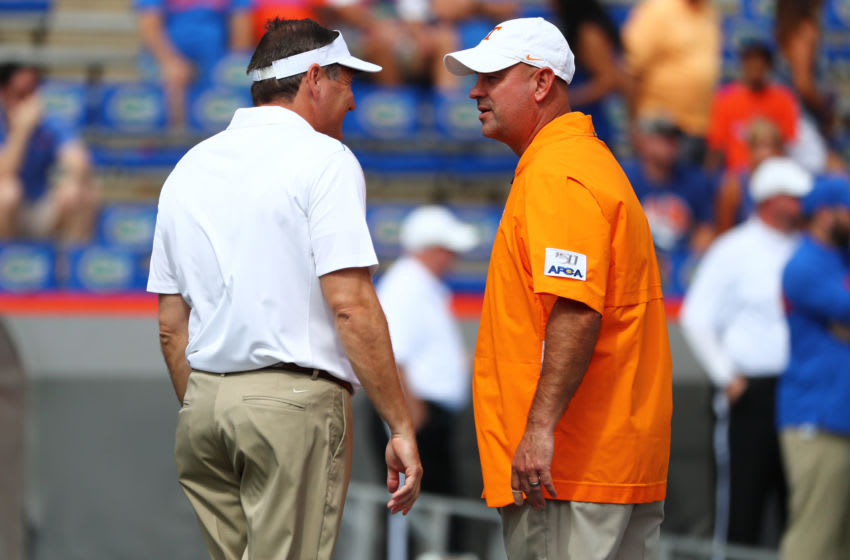 Sep 21, 2019; Gainesville, FL, USA; Florida Gators head coach Dan Mullen and Tennessee Volunteers head coach Jeremy Pruitt greet prior to the game at Ben Hill Griffin Stadium. Mandatory Credit: Kim Klement-USA TODAY Sports