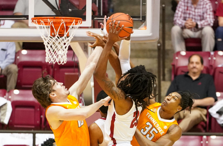 Feb 4, 2020; Tuscaloosa, Alabama, USA; Alabama Crimson Tide guard John Petty Jr. (23) goes to the basket against Tennessee Volunteers forward John Fulkerson (10) and guard Yves Pons (35) during the first half at Coleman Coliseum. Mandatory Credit: Marvin Gentry-USA TODAY Sports