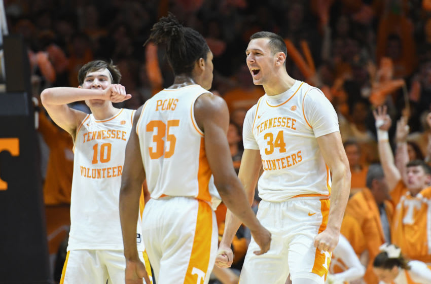 Feb 29, 2020; Knoxville, Tennessee, USA; Tennessee Volunteers forward John Fulkerson (10) and guard Yves Pons (35) and forward Uros Plavsic (34) react to a play against the Florida Gators during the first half at Thompson-Boling Arena. Mandatory Credit: Randy Sartin-USA TODAY Sports
