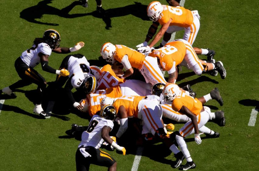 Tennessee quarterback Jarrett Guarantano (2) leaps over players to convert a 4th down during a SEC conference football game between the Tennessee Volunteers and the Missouri Tigers held at Neyland Stadium in Knoxville, Tenn., on Saturday, October 3, 2020. Kns Ut Football Missouri Bp