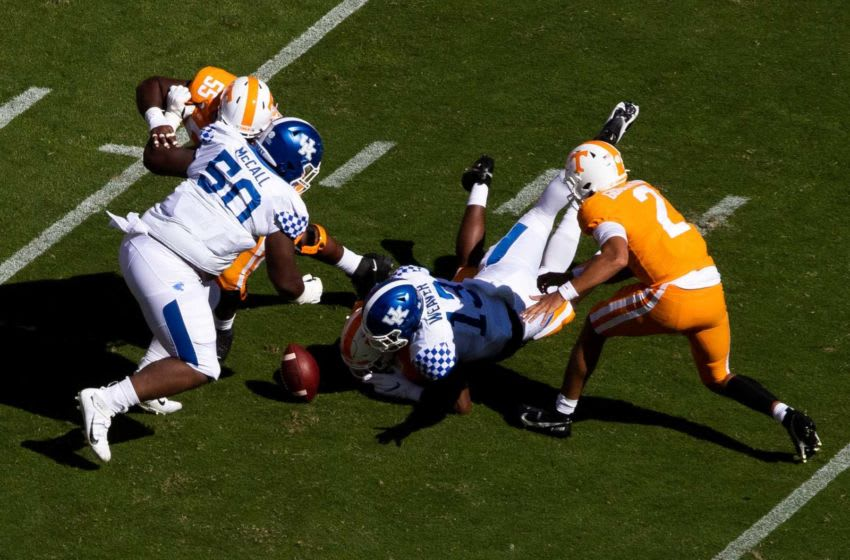 Tennessee quarterback Jarrett Guarantano (2) fumbles the ball and watches as its recovered by Kentucky during a SEC conference football game between the Tennessee Volunteers and the Kentucky Wildcats held at Neyland Stadium in Knoxville, Tenn., on Saturday, October 17, 2020. Kns Ut Football Kentucky Bp