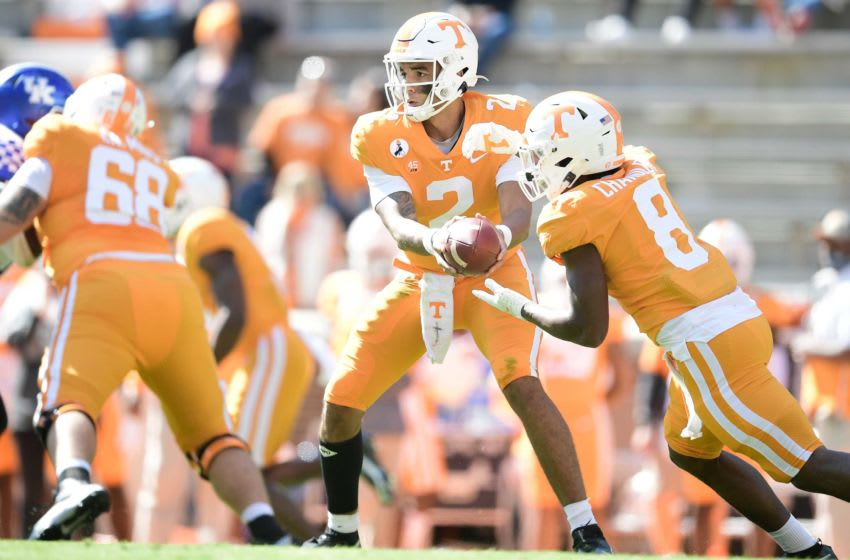 Tennessee quarterback Jarrett Guarantano (2) hands the ball off to Tennessee running back Ty Chandler (8) during a game between Tennessee and Kentucky at Neyland Stadium in Knoxville, Tenn. on Saturday, Oct. 17, 2020. 101720 Tenn Ky Gameaction