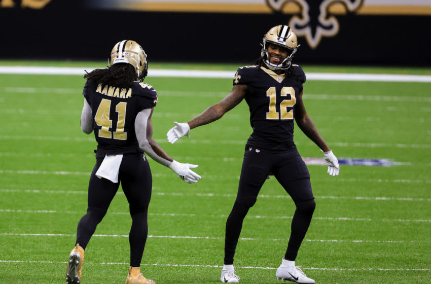 Oct 25, 2020; New Orleans, Louisiana, USA; New Orleans Saints running back Alvin Kamara (41) and wide receiver Marquez Callaway (12) celebrate after a first down against the Carolina Panthers during the second half at the Mercedes-Benz Superdome. Mandatory Credit: Derick E. Hingle-USA TODAY Sports