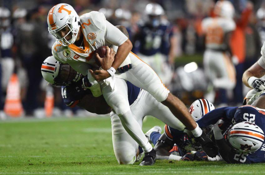 Auburn defensive tackle DaQuan Newkirk (44) takes Tennessee quarterback Jarrett Guarantano (2) down with him as Auburn defensive lineman Colby Wooden (25) grabs at Guarantano's ankle at Jordan-Hare Stadium in Auburn, Ala., on Saturday, Nov. 21, 2020. Auburn Ut