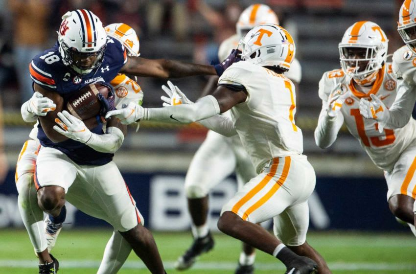 Auburn wide receiver Seth Williams (18) drags defenders for a few extra yards at Jordan-Hare Stadium in Auburn, Ala., on Saturday, Nov. 21, 2020. Auburn and Tennessee are tied 10-10 at halftime.