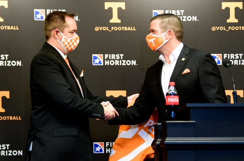 At left University of Tennessee head football coach Josh Heupel shakes hands with University of Tennessee athletics director Danny White after being presented a jersey, during a press conference announcing his hiring in the Stokely Family Media Center in Neyland Stadium, in Knoxville, Tenn., Wednesday, Jan.27, 2021. Heupel0127 0123