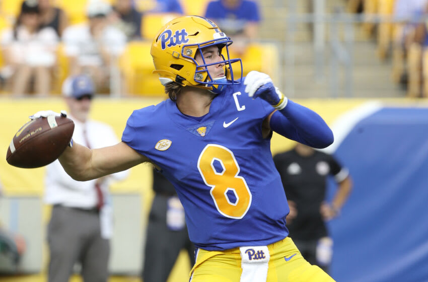 Sep 4, 2021; Pittsburgh, Pennsylvania, USA; Pittsburgh Panthers quarterback Kenny Pickett (8) passes against the Massachusetts Minutemen during the second quarter at Heinz Field. Mandatory Credit: Charles LeClaire-USA TODAY Sports