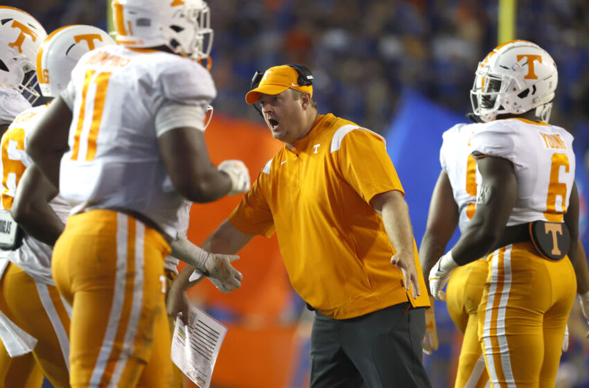 Sep 25, 2021; Gainesville, Florida, USA; Tennessee Volunteers head coach Josh Heupel reacts with teammates against the Florida Gators during the third quarter at Ben Hill Griffin Stadium. Mandatory Credit: Kim Klement-USA TODAY Sports