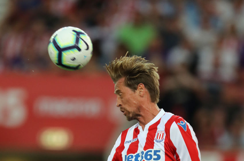 STOKE ON TRENT, ENGLAND - JULY 25: Peter Crouch of Stoke City heads the ball during the pre-season friendly match between Stoke City and Wolverhampton Wanderers at the Bet365 Stadium on July 25, 2018 in Stoke on Trent, England. (Photo by David Rogers/Getty Images)