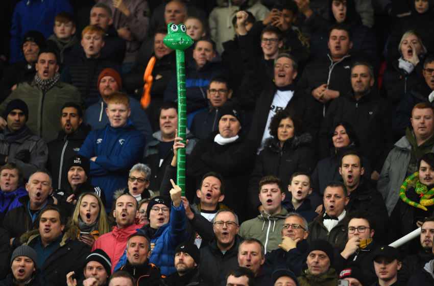 STOKE ON TRENT, ENGLAND - NOVEMBER 28: A fan poses with an inflatable snake during the Sky Bet Championship match between Stoke City and Derby County at Bet365 Stadium on November 28, 2018 in Stoke on Trent, England. (Photo by Nathan Stirk/Getty Images)