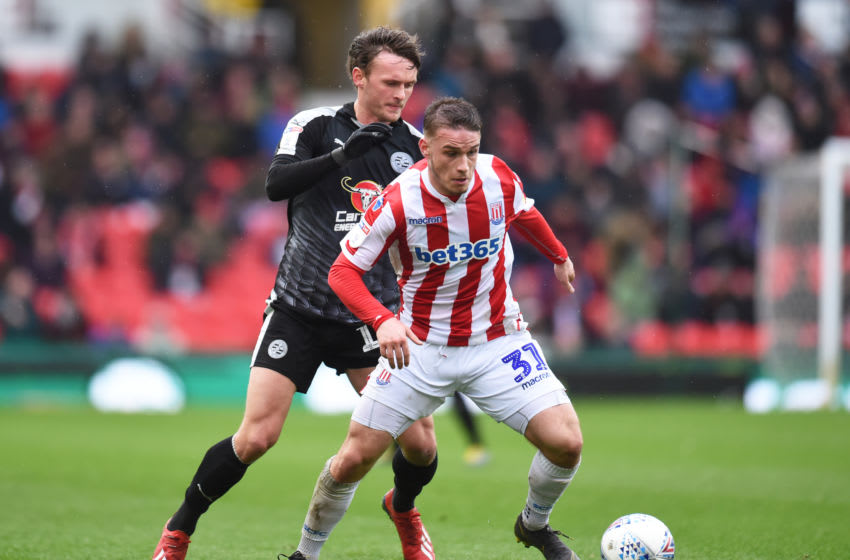 STOKE ON TRENT, ENGLAND - MARCH 16: Thibaud Verlinden of Stoke City and John Swift of Reading in action during the Sky Bet Championship between Stoke City and Reading at Bet365 Stadium on March 16, 2019 in Stoke on Trent, England. (Photo by Nathan Stirk/Getty Images)