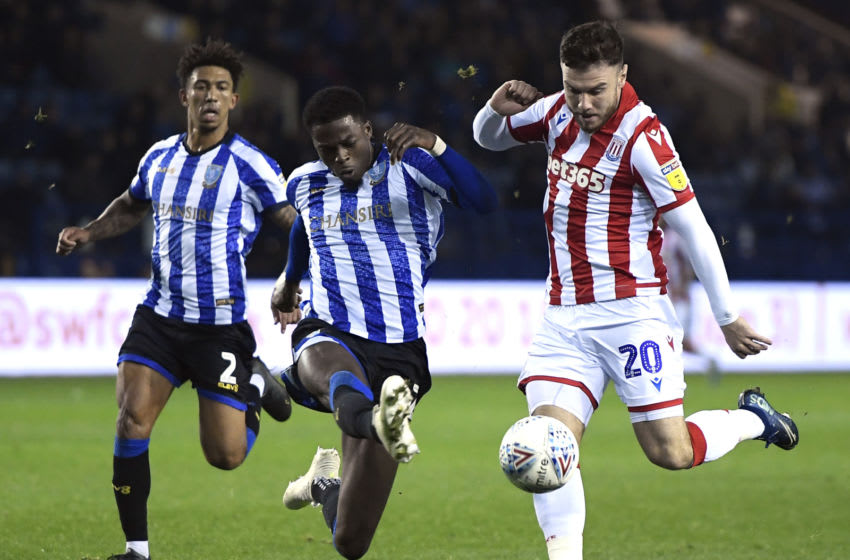 SHEFFIELD, ENGLAND - OCTOBER 22: Dominic Iorfa of Sheffield Wednesday tackles Scott Hogan of Stoke City during the Sky Bet Championship match between Sheffield Wednesday and Stoke City at Hillsborough Stadium on October 22, 2019 in Sheffield, England. (Photo by George Wood/Getty Images)