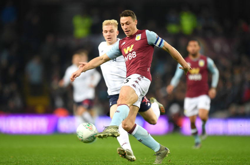 BIRMINGHAM, ENGLAND - DECEMBER 17: James Chester of Aston Villa controls the ball under pressure from Luis Longstaff of Liverpool during the Carabao Cup Quarter Final match between Aston Villa and Liverpool FC at Villa Park on December 17, 2019 in Birmingham, England. (Photo by Shaun Botterill/Getty Images)