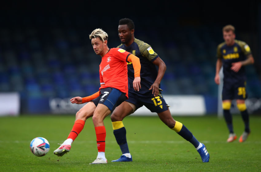 LUTON, ENGLAND - OCTOBER 17: Harry Cornick of Luton Town in action with John Obi Mikel of Stoke City during the Sky Bet Championship match between Luton Town and Stoke City at Kenilworth Road on October 17, 2020 in Luton, England. Sporting stadiums around the UK remain under strict restrictions due to the Coronavirus Pandemic as Government social distancing laws prohibit fans inside venues resulting in games being played behind closed doors. (Photo by Marc Atkins/Getty Images)