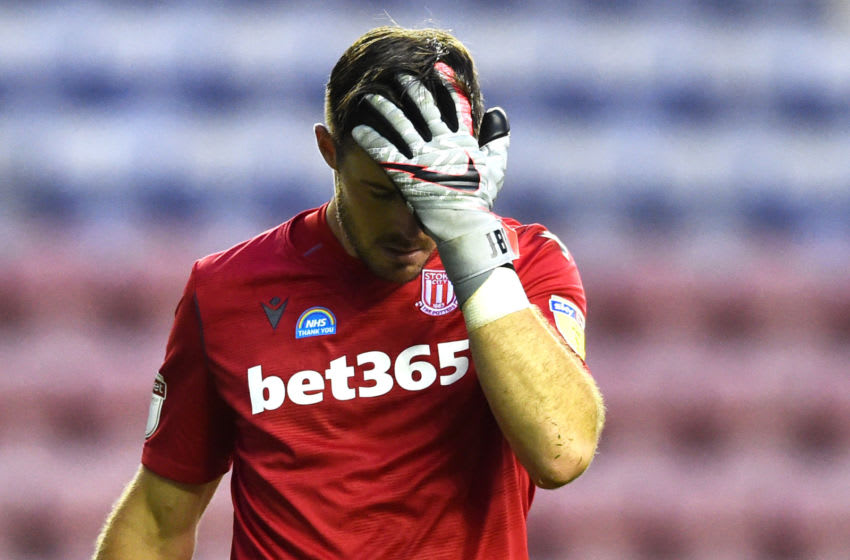 WIGAN, ENGLAND - JUNE 30: Jack Butland of Stoke City looks dejected during the Sky Bet Championship match between Wigan Athletic and Stoke City at DW Stadium on June 30, 2020 in Wigan, England. (Photo by Nathan Stirk/Getty Images)