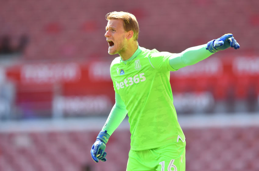 STOKE ON TRENT, ENGLAND - JULY 12: Adam Davies of Stoke City gestures during the Sky Bet Championship match between Stoke City and Birmingham City at Bet365 Stadium on July 12, 2020 in Stoke on Trent, England. (Photo by Nathan Stirk/Getty Images)