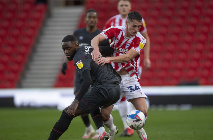 STOKE ON TRENT, ENGLAND - OCTOBER 24: Josh Dasilva of Brentford and Jordan Thompson of Stoke City in action during the Sky Bet Championship match between Stoke City and Brentford at Bet365 Stadium on October 24, 2020 in Stoke on Trent, England. Sporting stadiums around the UK remain under strict restrictions due to the Coronavirus Pandemic as Government social distancing laws prohibit fans inside venues resulting in games being played behind closed doors. (Photo by Visionhaus)