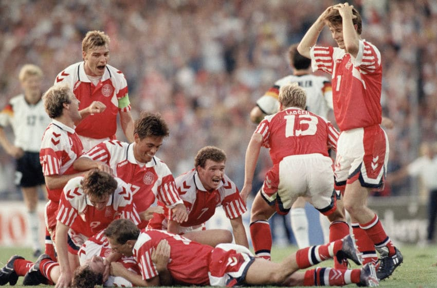 GOTHENBURG, SWEDEN - JUNE 26: Kim Vilfort of Denmark is mobbed by team-mates after scoring the second and winning goal during the UEFA European Championships 1992 Final between Denmark and Germany held at the Ullevi Stadium on June 26, 1992 in Gothernburg, Sweden. (Photo by Shaun Botterill/Allsport/Getty Images)