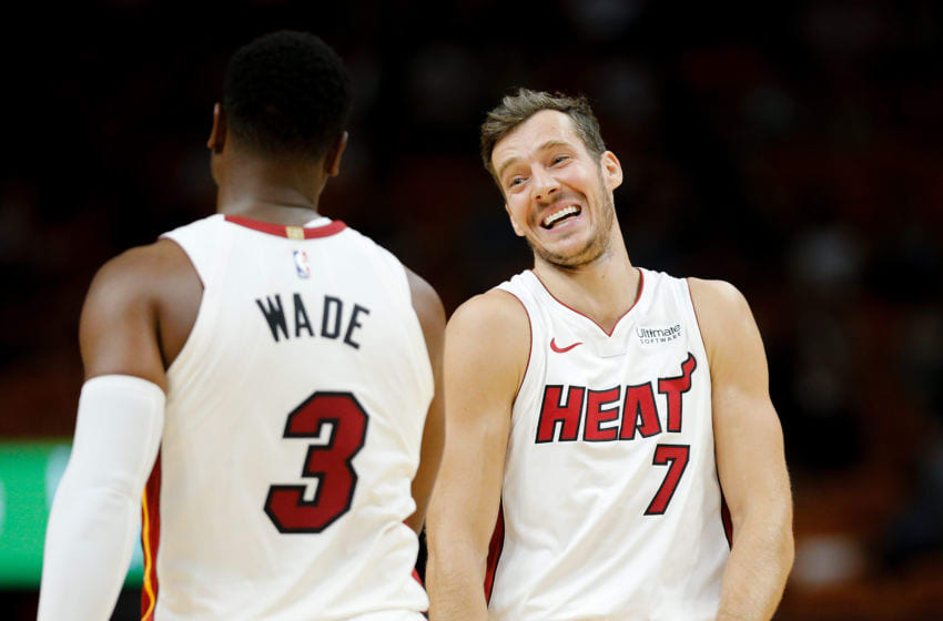 MIAMI, FL - OCTOBER 08: Goran Dragic #7 and Dwyane Wade #3 of the Miami Heat look on against the Orlando Magic during the first half at American Airlines Arena on October 8, 2018 in Miami, Florida. NOTE TO USER: User expressly acknowledges and agrees that, by downloading and or using this photograph, User is consenting to the terms and conditions of the Getty Images License Agreement. (Photo by Michael Reaves/Getty Images)