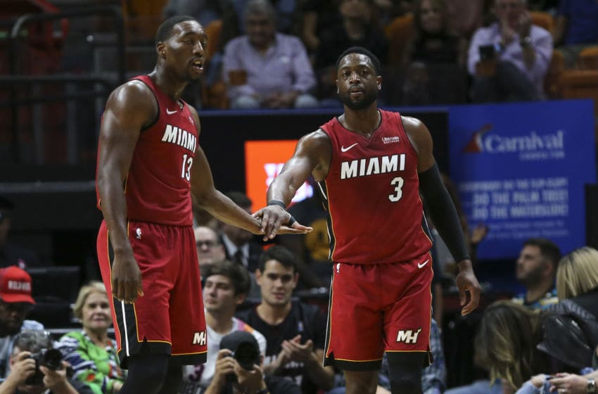 Dwyane Wade #3 and Bam Adebayo #13 of the Miami Heat celebrate against the Portland Trail Blazers (Photo by Michael Reaves/Getty Images)