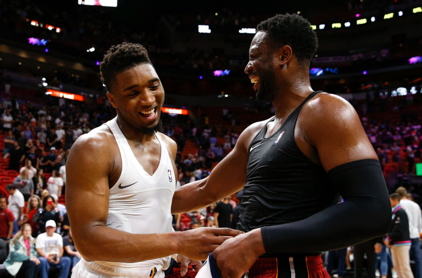 Dwyane Wade #3 of the Miami Heat talks with Donovan Mitchell #45 of the Utah Jazz after the game at American Airlines Arena. (Photo by Michael Reaves/Getty Images)