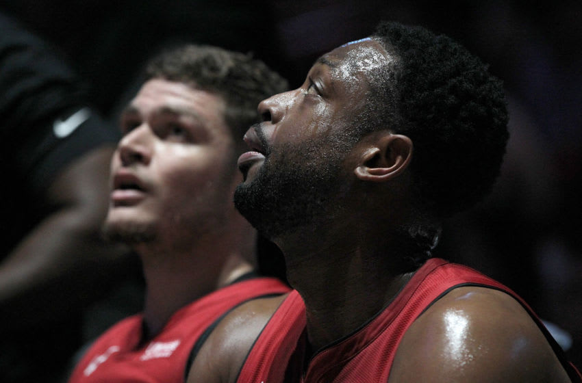 Miami Heat guards Tyler Johnson and Dwayne Wade at the bench during a time out in the second quarter against the Orlando Magic on Tuesday, Dec. 4, 2018 at AmericanAirlines Arena in Miami, Fla. (Pedro Portal/Miami Herald/TNS via Getty Images)
