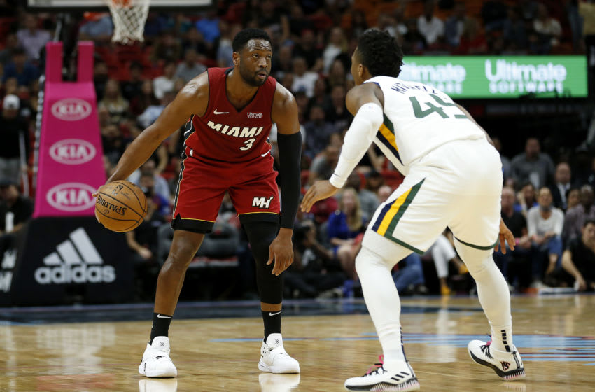 Dwyane Wade #3 of the Miami Heat is guarded by Donovan Mitchell #45 of the Utah Jazz (Photo by Michael Reaves/Getty Images)