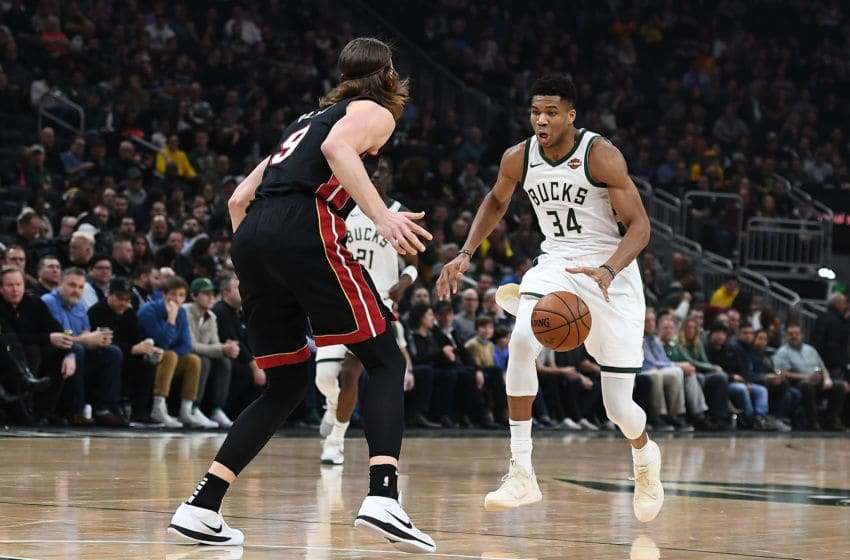 MILWAUKEE, WISCONSIN - JANUARY 15: Giannis Antetokounmpo #34 of the Milwaukee Bucks is defended by Kelly Olynyk #9 of the Miami Heat during a game at Fiserv Forum on January 15, 2019 in Milwaukee, Wisconsin. NOTE TO USER: User expressly acknowledges and agrees that, by downloading and or using this photograph, User is consenting to the terms and conditions of the Getty Images License Agreement. (Photo by Stacy Revere/Getty Images)