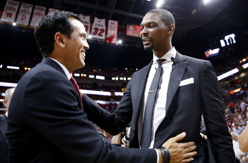 Former Miami Heat player Chris Bosh hugs head coach Erik Spoelstra of the Miami Heat during his jersey retirement ceremony (Photo by Michael Reaves/Getty Images)