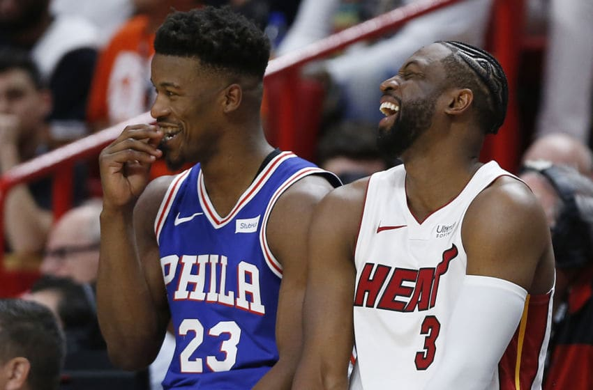 MIAMI, FLORIDA - APRIL 09: Dwyane Wade #3 of the Miami Heat talks with Jimmy Butler #23 of the Philadelphia 76ers as they wait to check in to the game at the scorers table during the first half at American Airlines Arena on April 09, 2019 in Miami, Florida. NOTE TO USER: User expressly acknowledges and agrees that, by downloading and or using this photograph, User is consenting to the terms and conditions of the Getty Images License Agreement. (Photo by Michael Reaves/Getty Images)