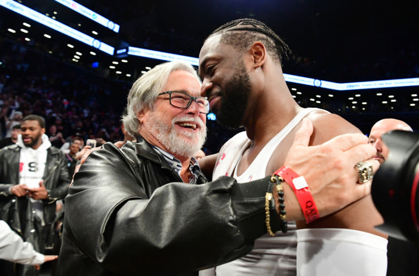 Dwyane Wade #3 of the Miami Heat hugs Miami Heat owner Micky Arison after the game against the Brooklyn Nets (Photo by Sarah Stier/Getty Images)
