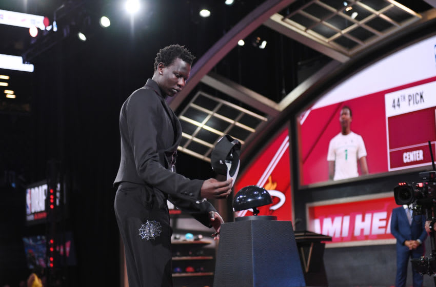 Bol Bol reaches for the hat after being drafted forty fourth overall by the Miami Heat (Photo by Matteo Marchi/NBAE via Getty Images)