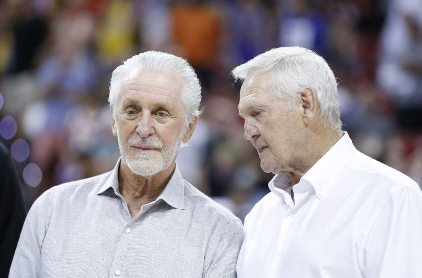 President Pat Riley of the Miami Heat (L) talks with executive board member Jerry West of the LA Clippers (Photo by Michael Reaves/Getty Images)