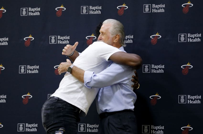Jimmy Butler #22 of the Miami Heat hugs president Pat Riley after his introductory press conference (Photo by Michael Reaves/Getty Images)