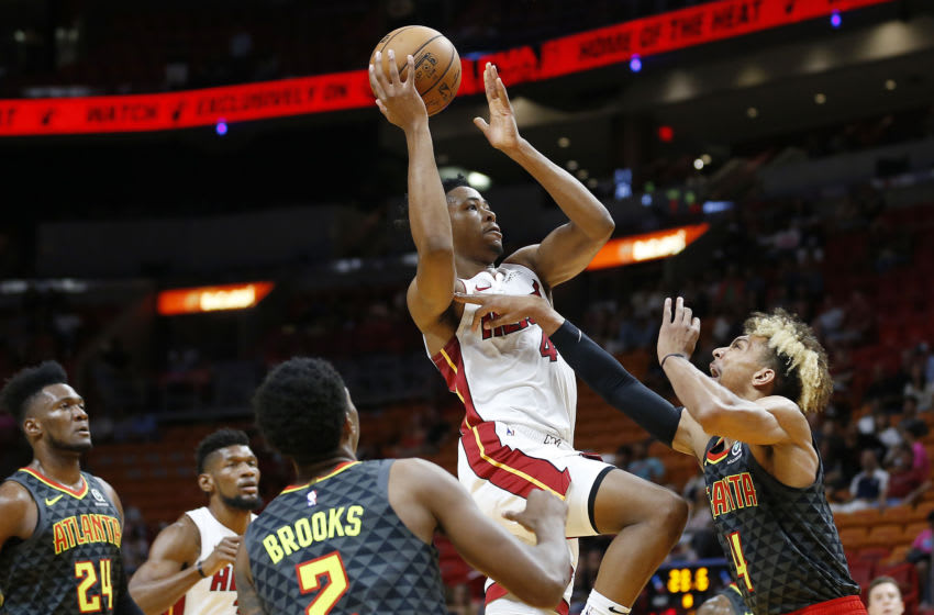 KZ Okpala #4 of the Miami Heat attempts a layup against Charlie Brown Jr. #4 of the Atlanta Hawks (Photo by Michael Reaves/Getty Images)