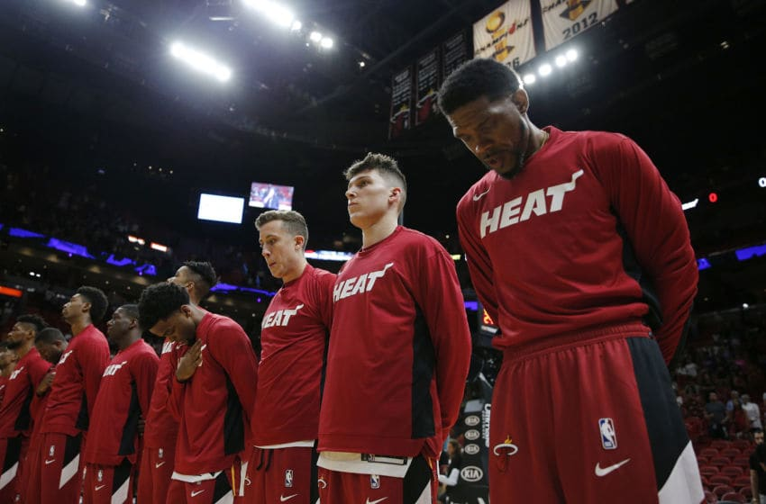 Duncan Robinson #55, Tyler Herro #14 and Udonis Haslem #40 of the Miami Heat (Photo by Michael Reaves/Getty Images)