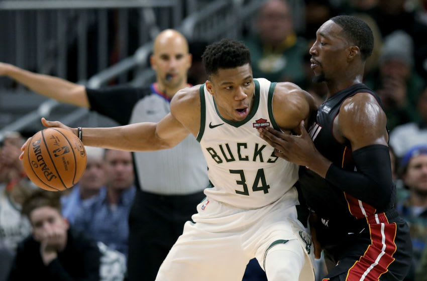 Giannis Antetokounmpo #34 of the Milwaukee Bucks dribbles the ball while being guarded by Bam Adebayo #13 of the Miami Heat (Photo by Dylan Buell/Getty Images)