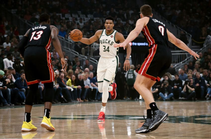 Giannis Antetokounmpo #34 of the Milwaukee Bucks dribbles the ball while being guarded by Bam Adebayo #13 and Meyers Leonard #0 of the Miami Heat (Photo by Dylan Buell/Getty Images)