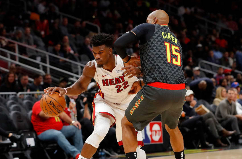 Jimmy Butler #22 of the Miami Heat drives against Vince Carter #15 of the Atlanta Hawks (Photo by Kevin C. Cox/Getty Images)