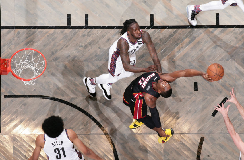 BROOKLYN, NY - DECEMBER 1: Bam Adebayo #13 of the Miami Heat grabs the rebound against the Brooklyn Nets on December 1, 2019 at Barclays Center in Brooklyn, New York. NOTE TO USER: User expressly acknowledges and agrees that, by downloading and or using this Photograph, user is consenting to the terms and conditions of the Getty Images License Agreement. Mandatory Copyright Notice: Copyright 2019 NBAE (Photo by Nathaniel S. Butler/NBAE via Getty Images)