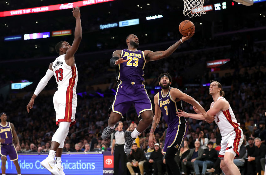 LeBron James #23 of the Los Angeles Lakers drives past Bam Adebayo #13 of the Miami Heat for a layup (Photo by Sean M. Haffey/Getty Images)