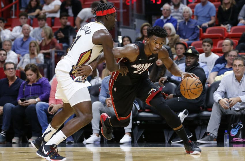 Jimmy Butler #22 of the Miami Heat drives to the basket against Jrue Holiday (Photo by Michael Reaves/Getty Images)